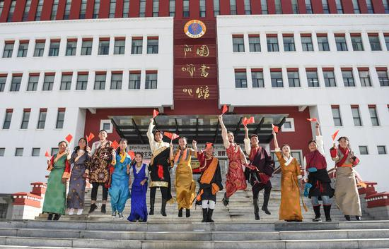 Students perform during an event to celebrate the 70th anniversary of the founding of the People's Republic of China at Tibet University in Lhasa, capital of southwest China's Tibet Autonomous Region, Sept. 12, 2019. (Xinhua/Jigme Dorje)
